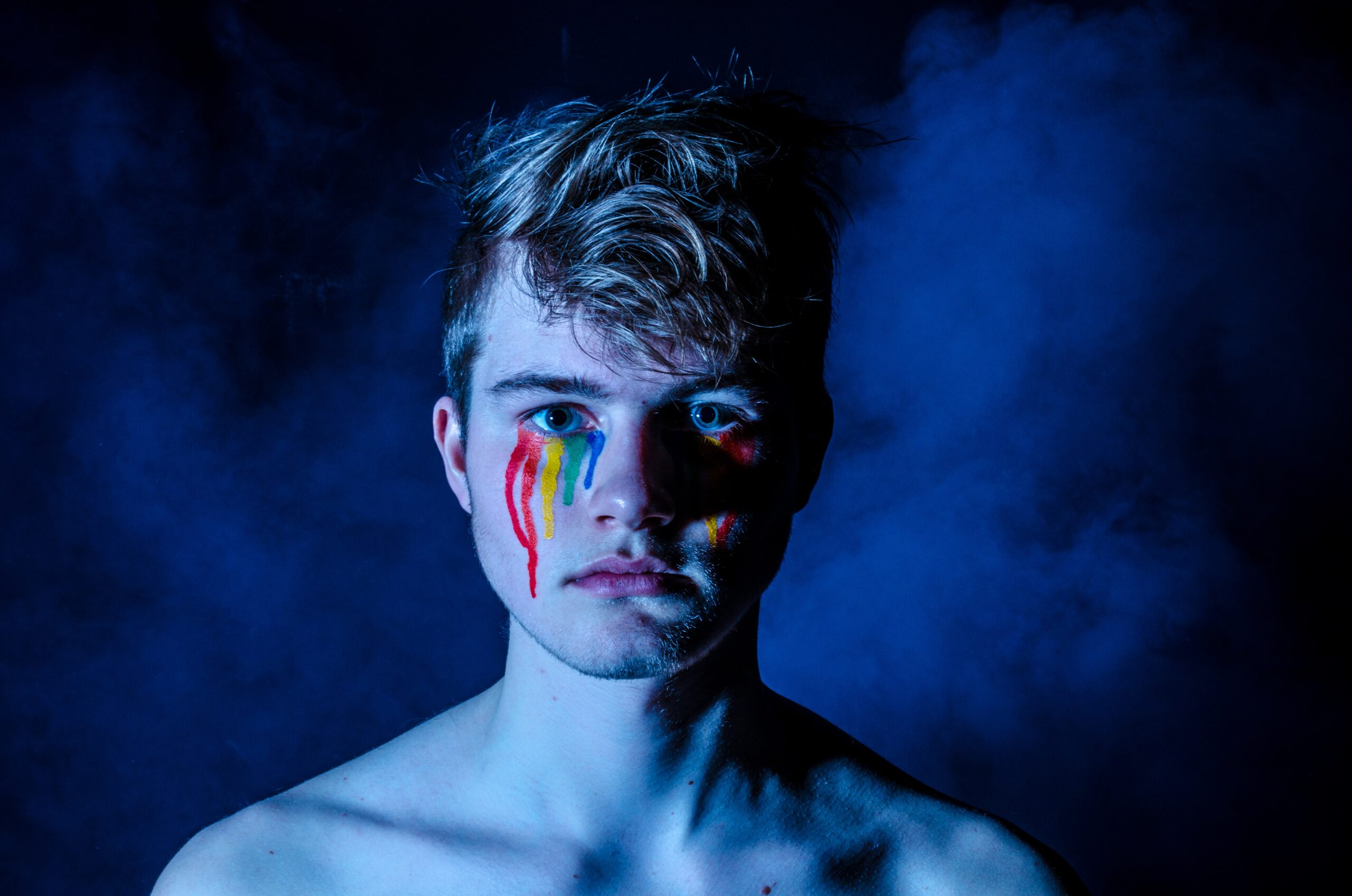 photo of man crying with colored tears